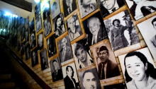 Stairs and wall with photos of Iraqi cultural workers